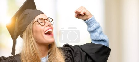 Photo for Young woman university graduate student happy and excited celebrating victory expressing big success, power, energy and positive emotions. Celebrates new job joyful - Royalty Free Image
