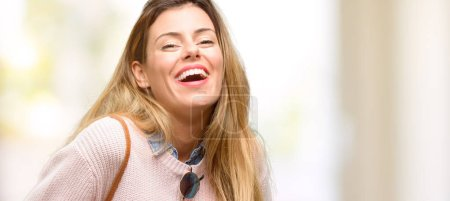Young trendy woman confident and happy with a big natural smile laughing