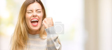 Photo for Young beautiful woman irritated and angry expressing negative emotion, annoyed with someone - Royalty Free Image