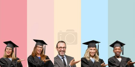 Photo for Senior teacher with his graduate students holding something in empty hand - Royalty Free Image