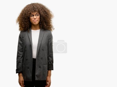 African american business woman wearing glasses smiling looking side and staring away thinking.