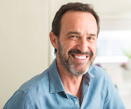 Photo for Handsome middle age man with a happy face standing and smiling with a confident smile showing teeth - Royalty Free Image