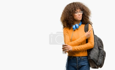 African american student woman pointing away side with finger