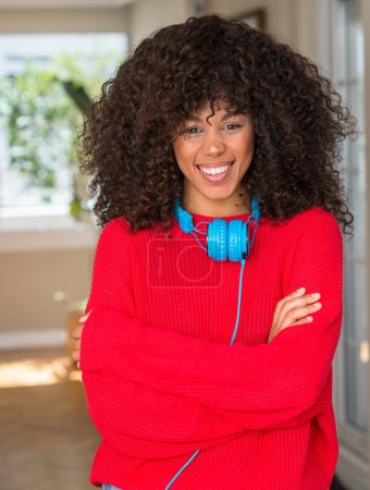 Photo for African american woman wearing headphones happy face smiling with crossed arms looking at the camera. Positive person. - Royalty Free Image