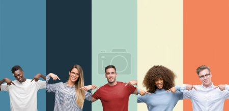 Group of people over vintage colors background looking confident with smile on face, pointing oneself with fingers proud and happy.