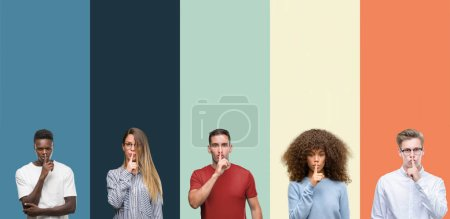 Group of people over vintage colors background asking to be quiet with finger on lips. Silence and secret concept.
