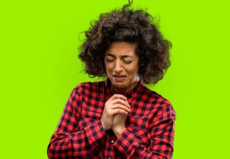 Photo for Beautiful arab woman crying depressed full of sadness expressing sad emotion - Royalty Free Image