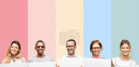 Mixed group of people, women and men holding blank advertising banner, good poster for ad, offer or announcement, big paper billboard