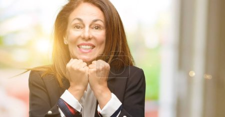 Photo for Middle age woman wearing jacket terrified and nervous expressing anxiety and panic gesture, overwhelmed - Royalty Free Image