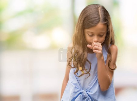 Brunette hispanic girl feeling unwell and coughing as symptom for cold or bronchitis. Healthcare concept.