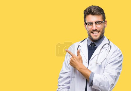 Photo for Young handsome doctor man over isolated background cheerful with a smile of face pointing with hand and finger up to the side with happy and natural expression on face looking at the camera. - Royalty Free Image
