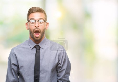 Young handsome business man over isolated background afraid and shocked with surprise expression, fear and excited face.