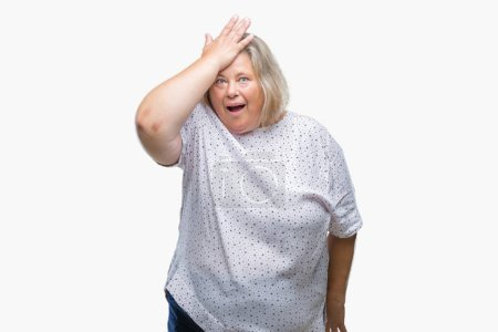 Senior plus size caucasian woman over isolated background surprised with hand on head for mistake, remember error. Forgot, bad memory concept.