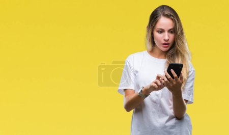 Photo for Young beautiful blonde woman using smartphone over isolated background scared in shock with a surprise face, afraid and excited with fear expression - Royalty Free Image