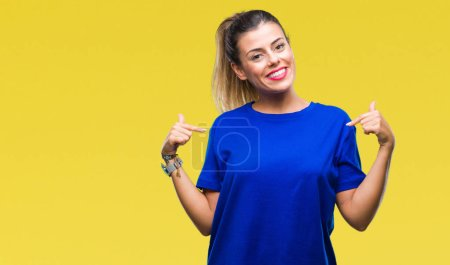 Photo for Young beautiful woman wearing casual blue t-shirt over isolated background looking confident with smile on face, pointing oneself with fingers proud and happy. - Royalty Free Image