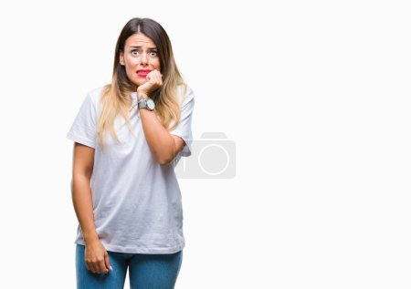 Photo for Young beautiful woman casual white t-shirt over isolated background looking stressed and nervous with hands on mouth biting nails. Anxiety problem. - Royalty Free Image