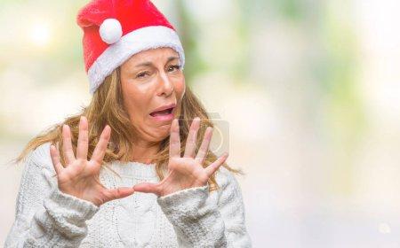 Middle age senior hispanic woman wearing christmas...