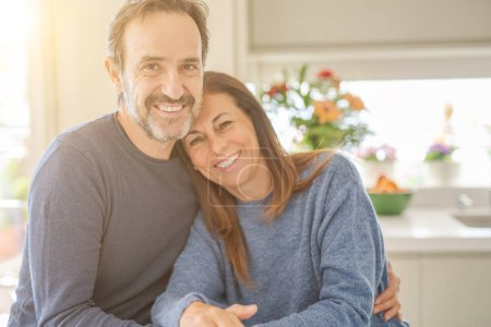 Photo for Romantic middle age couple sitting together at home - Royalty Free Image
