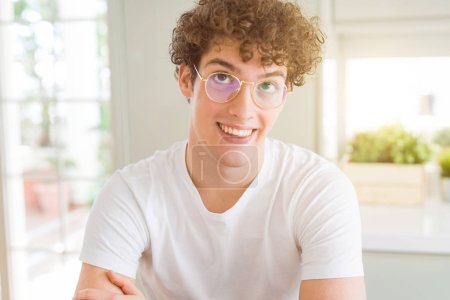 Photo for Young handsome man wearing glasses smiling looking side and staring away thinking. - Royalty Free Image