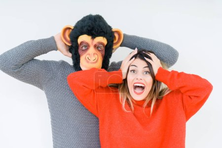 Photo for Funny young couple, boyfriend wearing monkey mask, crazy and idiot relationship in love - Royalty Free Image