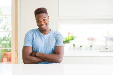 Photo for Handsome african american man wearing casual t-shirt at home happy face smiling with crossed arms looking at the camera. Positive person. - Royalty Free Image