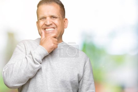 Photo for Middle age arab man wearing sport sweatshirt over isolated background looking confident at the camera with smile with crossed arms and hand raised on chin. Thinking positive. - Royalty Free Image
