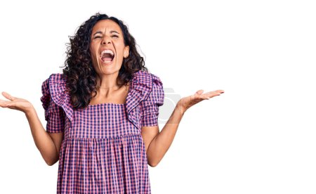 Photo for Middle age beautiful woman wearing casual dress celebrating mad and crazy for success with arms raised and closed eyes screaming excited. winner concept - Royalty Free Image