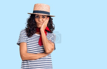 Photo for Middle age beautiful woman wearing casual striped t shirt and summer hat thinking looking tired and bored with depression problems with crossed arms. - Royalty Free Image