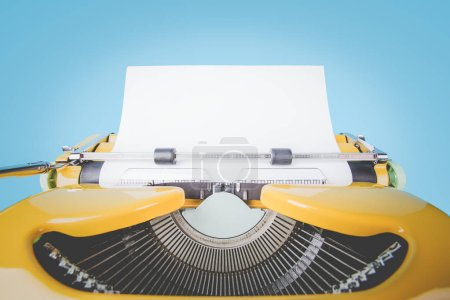 Retro old yellow typewriter with paper on blue background.
