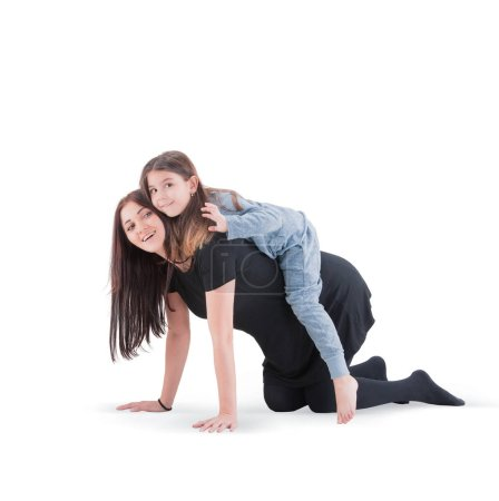 Loving mother and her daughter child girl playing and hugging on white background. Concept of happy. Studio shoot