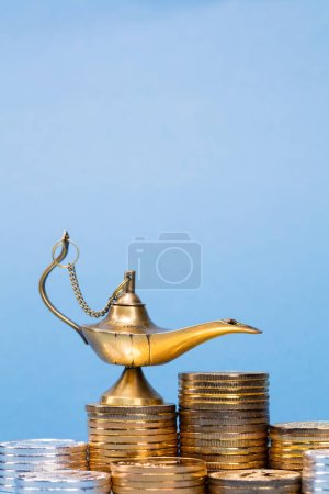 Photo for Magic lamp of wishes with smoke coming out from the lamp - Royalty Free Image