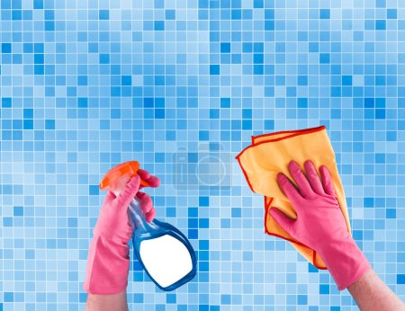 Photo for Colorful cleaning set for different surfaces in kitchen, bathroom and other rooms on kitchen mosaic surface background. Top view of cleaning service concept. - Royalty Free Image