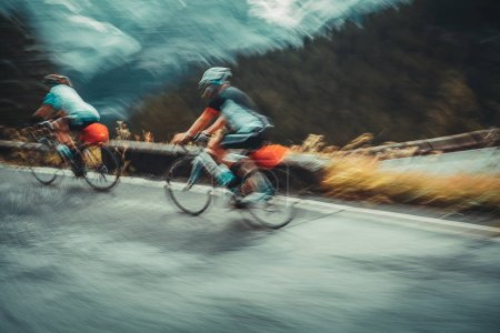 Slow motion photo of a two sportsmans riding bicycles, cycling championship in Alpine mountains, active sportive lifestyle