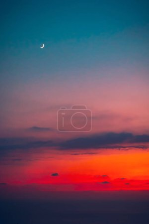 Photo for Beautiful sunset with a moon, new moon, beauty of a moon cycle, amazing night skyscape, autumn season nature - Royalty Free Image
