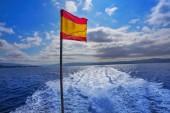 Vigo skyline and flag from the sea of Galicia Spain