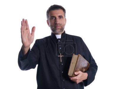 Priest male blessing hand with holy Bible in hand