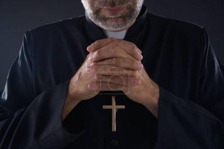 Praying hands priest portrait of male pastor