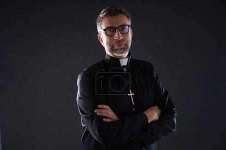 Crossed arms priest portrait senior male