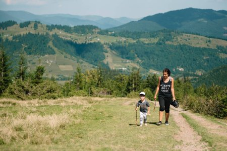 Photo for Young mom with baby boy travelling. Mother on hiking adventure with child, family trip in mountains. National Park. Hike with children. Active summer holidays. Fisheye lens - Royalty Free Image