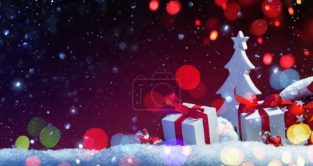 Photo for Holidays Decoration with Christmas Tree and Gifts on a Red Background with Colored Lights and Snow Effects - Royalty Free Image