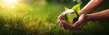 Photo for Green Planet in Your Hands. Save Earth. Environment Concept - Royalty Free Image
