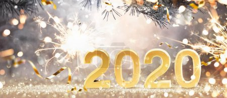 Foto de Happy New Year 2020. Golden Background with Sparklers and Confetti - Imagen libre de derechos