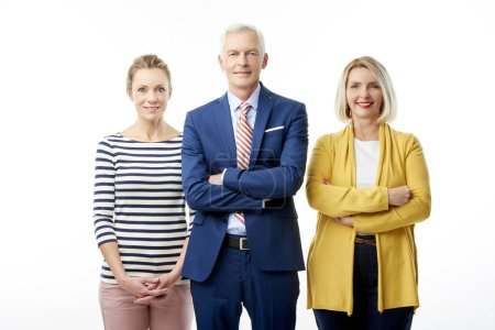 Photo pour Group of business people standing at isolated white background. Executive managing director businessman standing together with businesswomen. - image libre de droit
