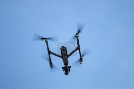 Professional heavy duty drone flying in the air.