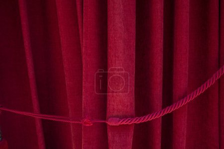 Close up view of traditional red stage curtain of a theater.