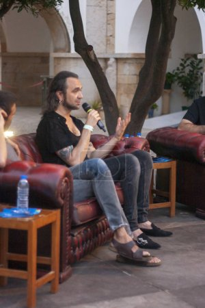 FARO, PORTUGAL: 2nd SEPTEMBER, 2018 - Manel Cruz and Fernando Ribeiro of Moonspell band, are interviewed by Valter Hugo Me in Festival F, a big festival in Faro, Portugal.