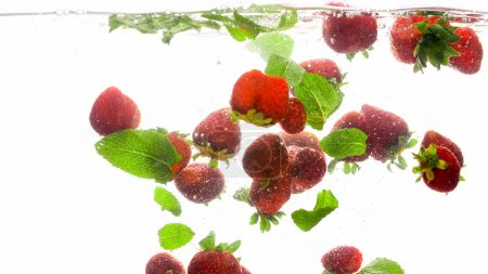 Photo for Closeup beautiful photo of lots of fresh raspberries and mint leaves flating in clear water - Royalty Free Image