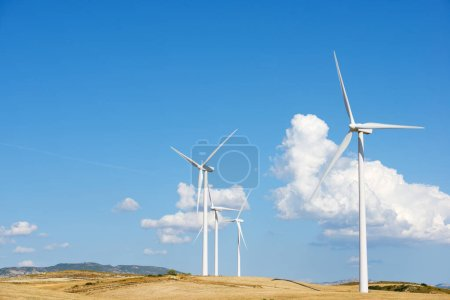 Photo for Wind turbines for electric power production, Zaragoza province, Aragon in Spain. - Royalty Free Image