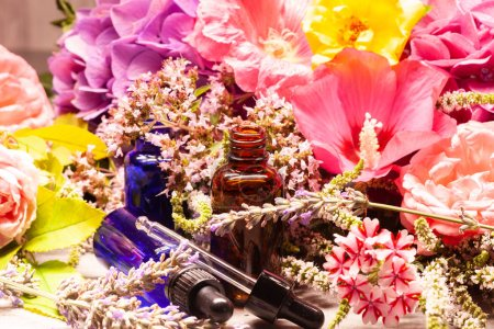 Spa composition of flowers and bottles of essential oils