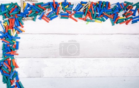 Photo for Set of different dowels for wood, concrete, plaster on an old wooden background. top view. - Royalty Free Image